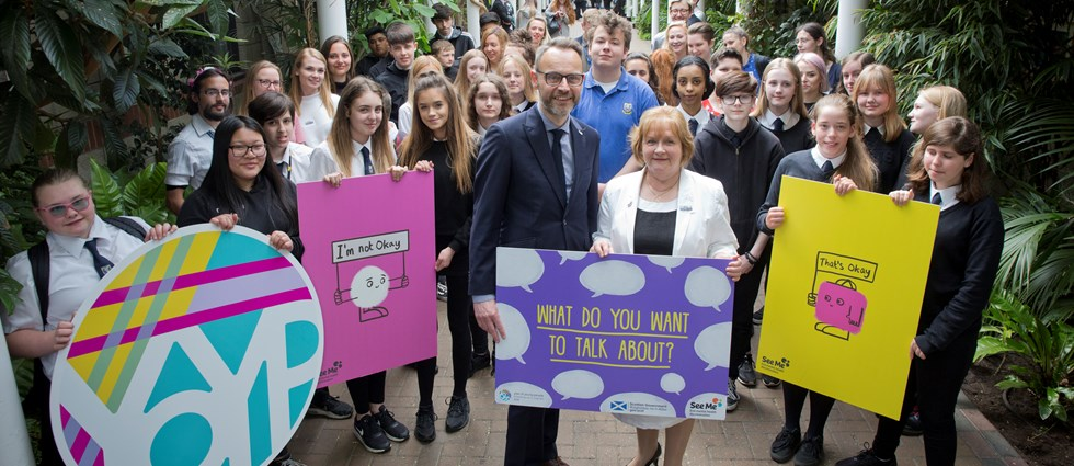 See Me volunteers, staff, the Scottish Government's mental health minister and pupils from Leith Academy