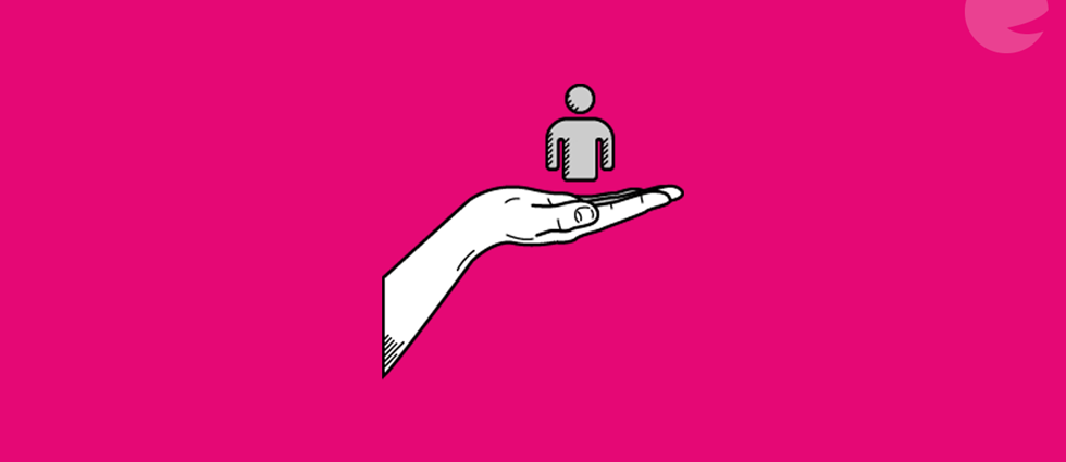 man in a hand on a pink background